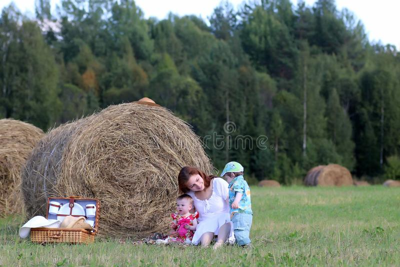 Mother with twins in field royalty free stock photo