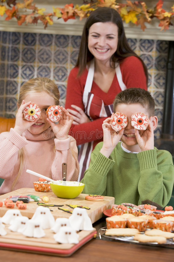 Download Mother And Two Children At Halloween In Kitchen Royalty Free Stock Photo - Image: 5942325