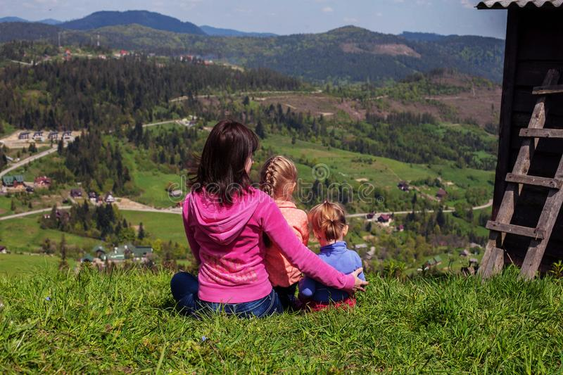 Mother and two children in the mountains. The concept of travel. And lifestyle stock images