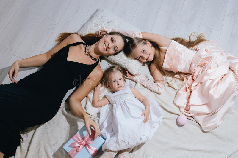 Mother and two daughters enjoy life. happy family stock images