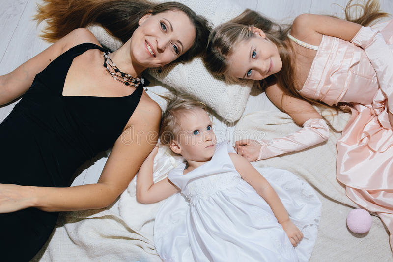Mother and two daughters enjoy life. happy family royalty free stock photo