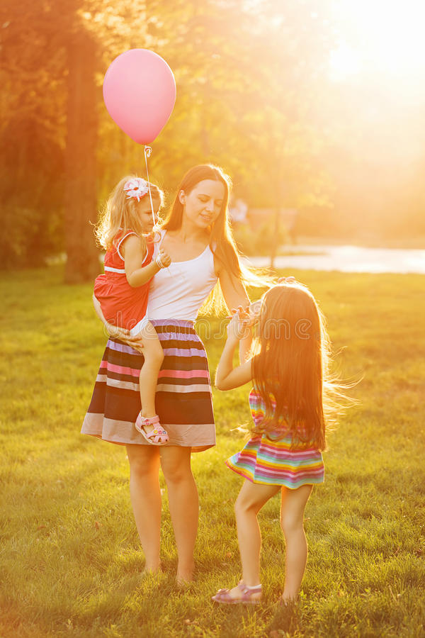 Mother and two daughters on a picnic royalty free stock images
