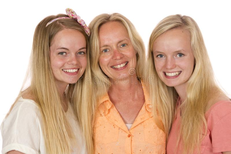 Mother and Two Daughters Pose royalty free stock photos