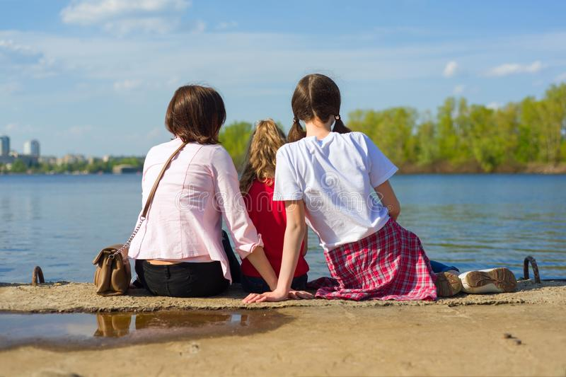 Mother and two daughters. Watching the water royalty free stock images