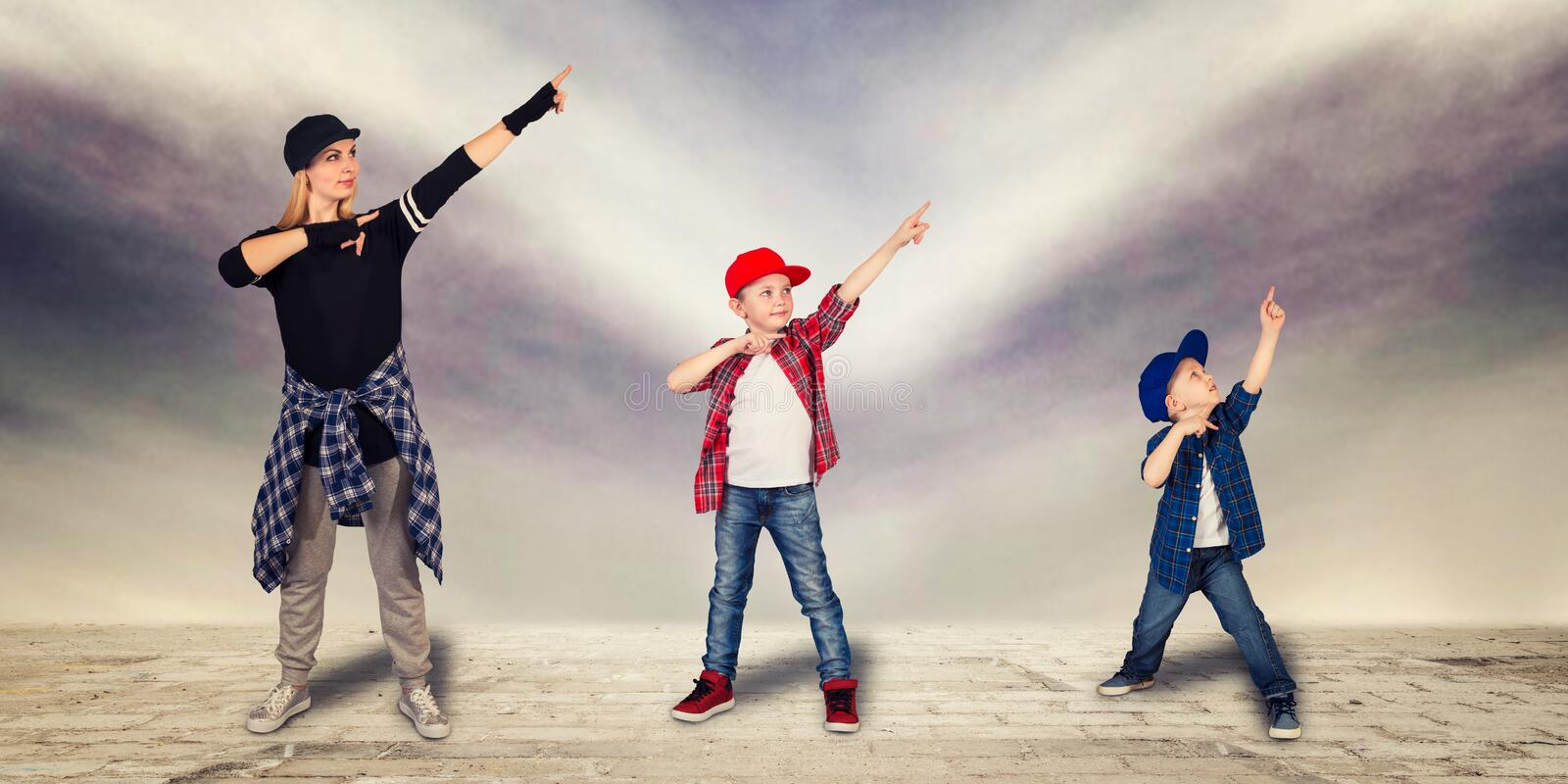 Mother and two son dance hip-hop.Urban lifestyle. Hip-hop generation. royalty free stock photo