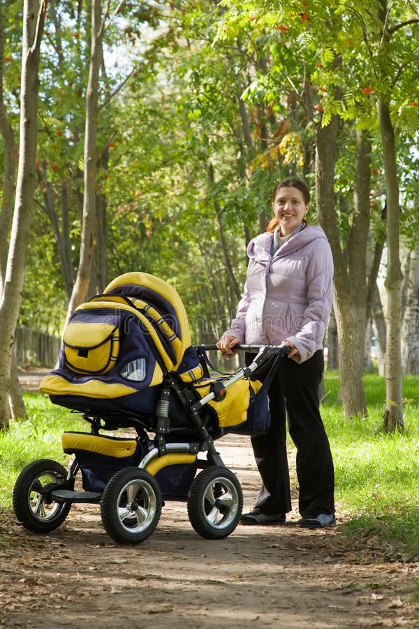 Mother walking with pram