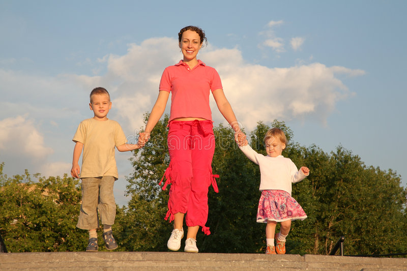 Mother Walks With Children Royalty Free Stock Images