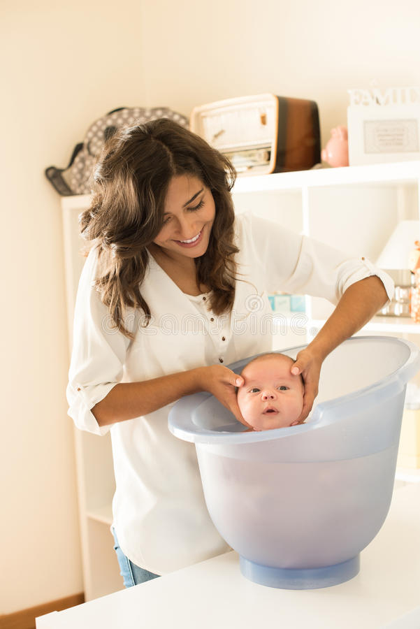 Mother Washing Baby In Bath Tub Stock Image - Image of small, happy ...