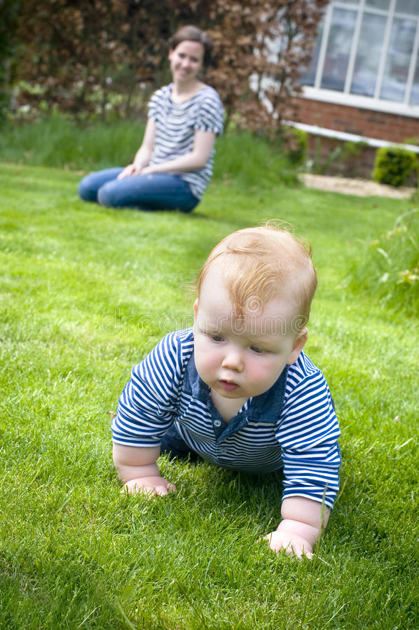 Free Mother With Baby Learning To Crawl Royalty Free Stock Photo - 27665765
