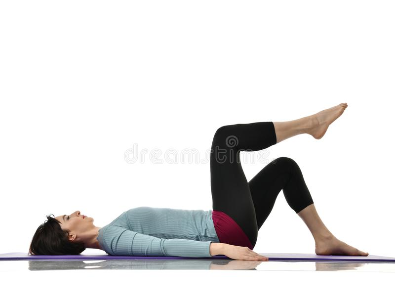 Mother woman exercising doing postnatal workout. Female fitness instructor stretching hands and legs in gym and work out exercises royalty free stock photos