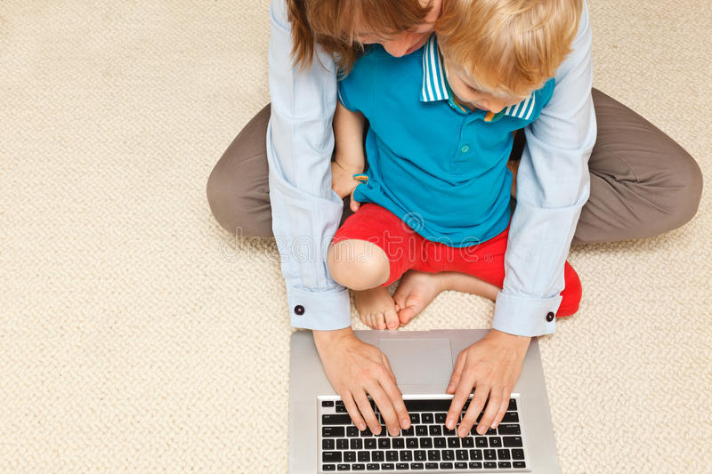 Mother working from home royalty free stock photos