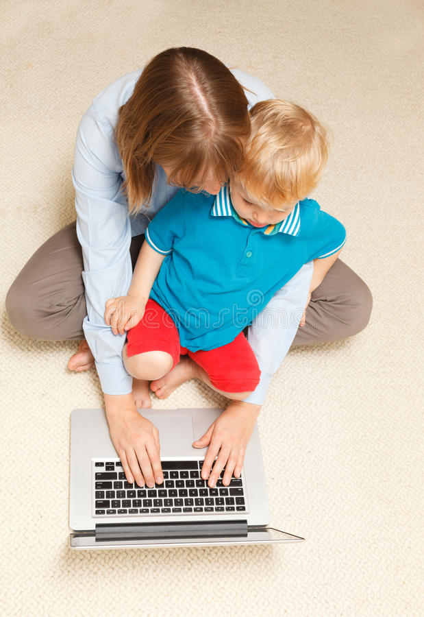 Download Mother Working From Home Royalty Free Stock Photography - Image: 27109837