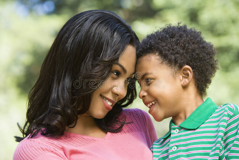 Mother and young son. stock images