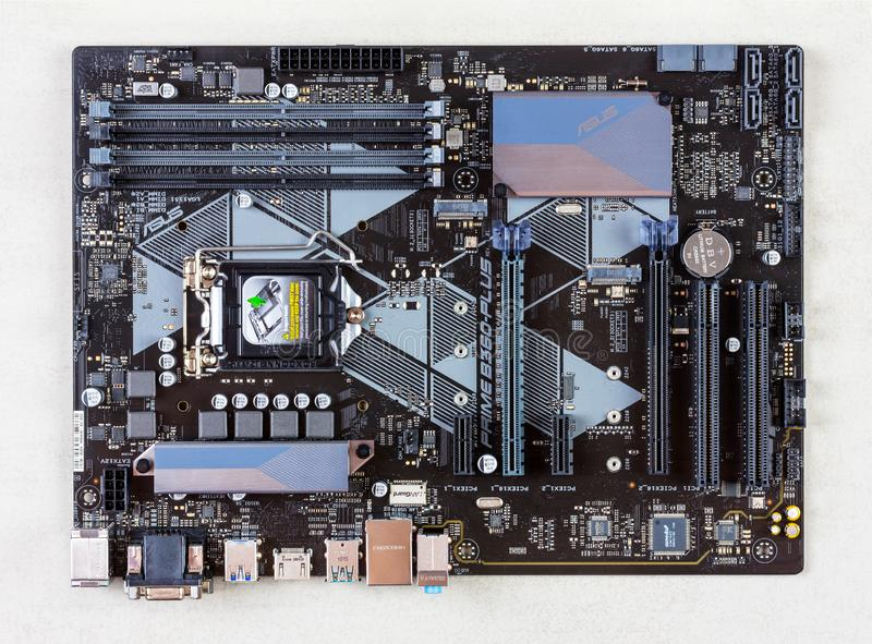 Motherboard asus on a gray background closeup top view stock photography