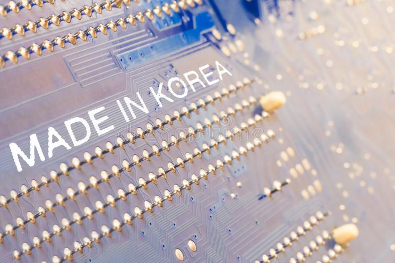 Motherboard. The inscription is made in Korea. macro photography is toning. Background business computer technology data asian north south information chip stock photo