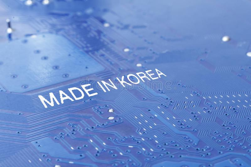 Motherboard. The inscription is made in Korea. macro photography is toning. Background business computer technology data asian north south information chip stock photography