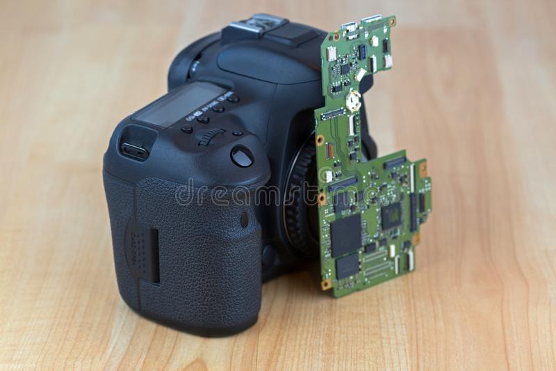 Motherboard Main board for Digital camera replacement on wooden royalty free stock photos