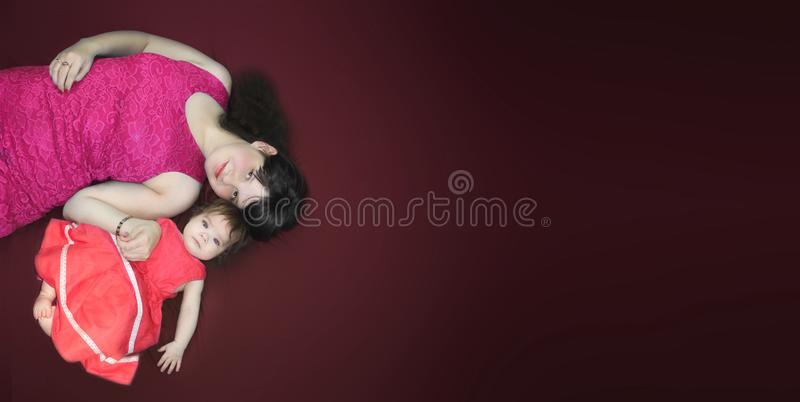 Motherhood concept. Mom and daughter royalty free stock image