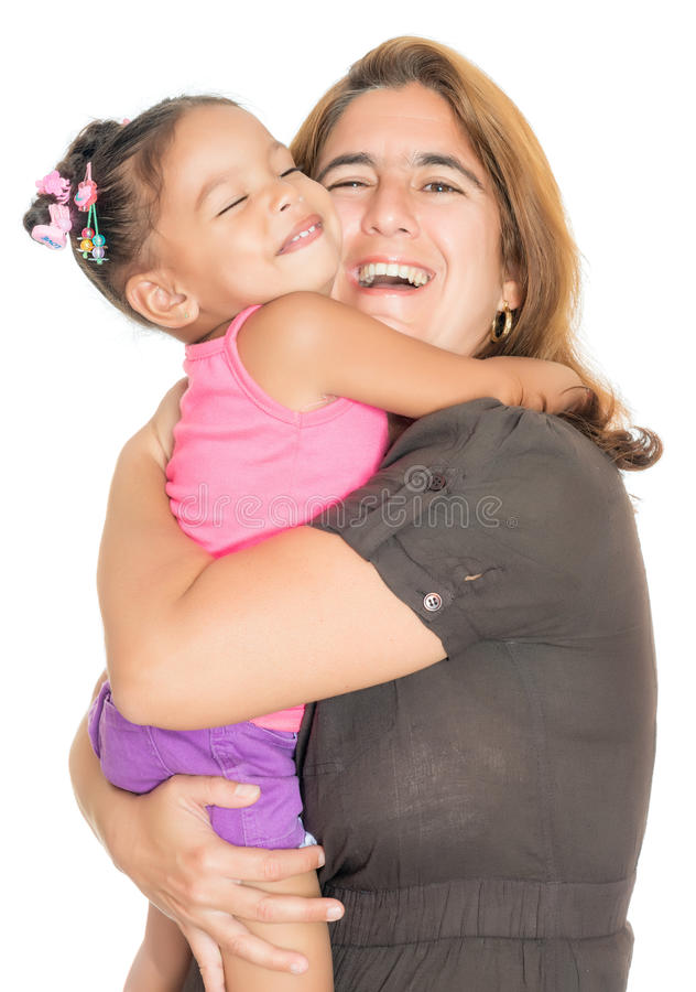 Motherhugging her small multiracial daughter and laughing royalty free stock images