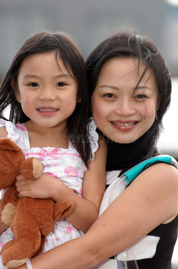 Download Motherly Love stock photo. Image of girl, oriental, black - 1471914