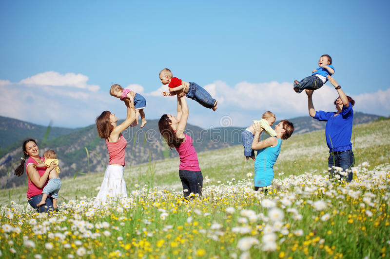 Mothers with children. In flower field