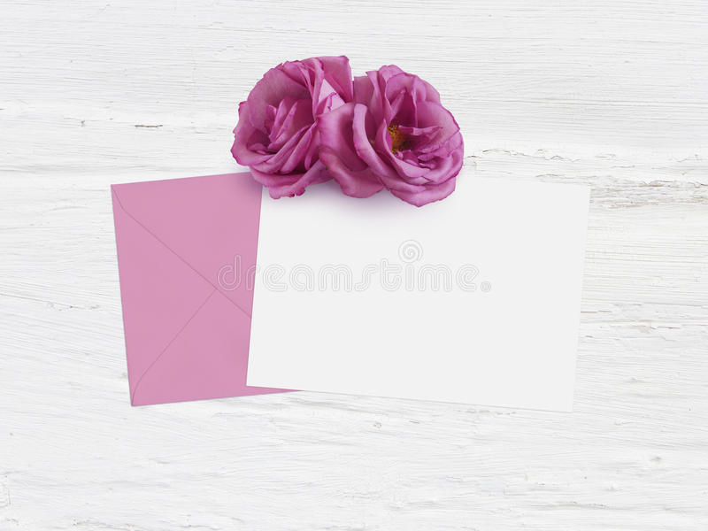 Mothers day, birthday or wedding mockup scene with envelope, blank card and rose flowers. Grunge white background, flat. Mothers day, birthday or wedding mockup royalty free stock images