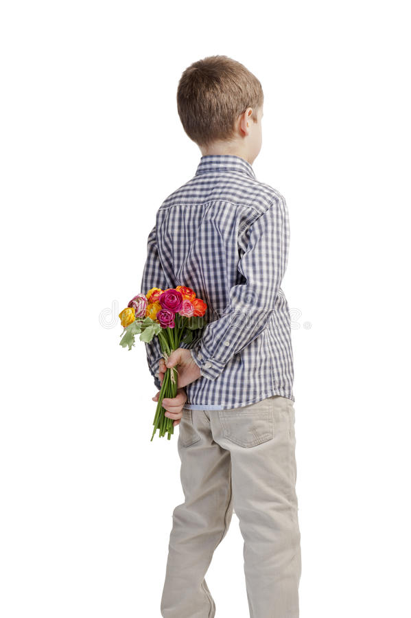 Mothers day: boy a bouquet of flowers stock photo