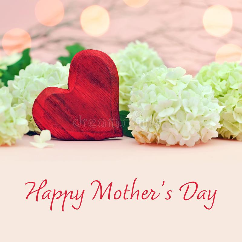 Mothers Day card with heart and flowers royalty free stock photos