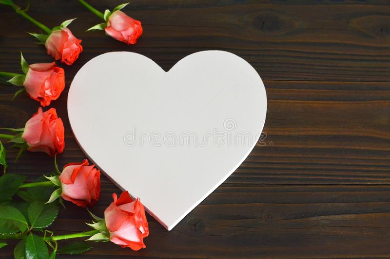 Mothers Day card with heart and roses. On wooden background royalty free stock photo