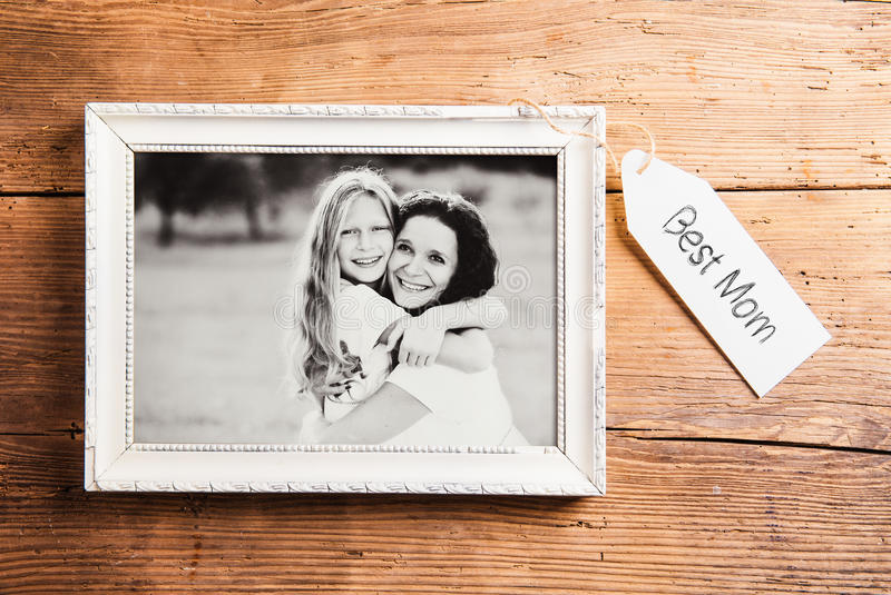 Mothers day composition. Picture frame. Wooden background. Studio shot. stock image