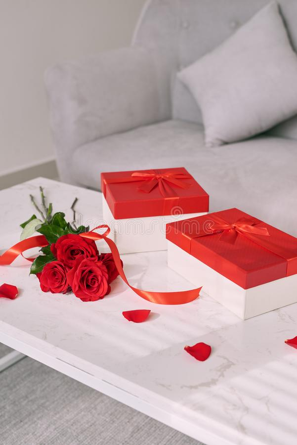 Mothers Day gifts and red rose on table. stock photo