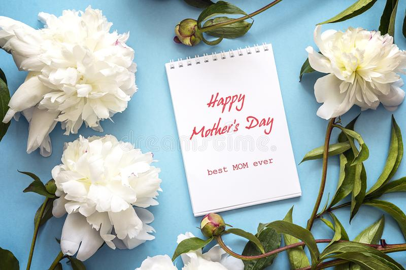 Mothers day greeting message with fresh white peonies on a blue download mothers day greeting message with fresh white peonies on a blue stock photo image m4hsunfo