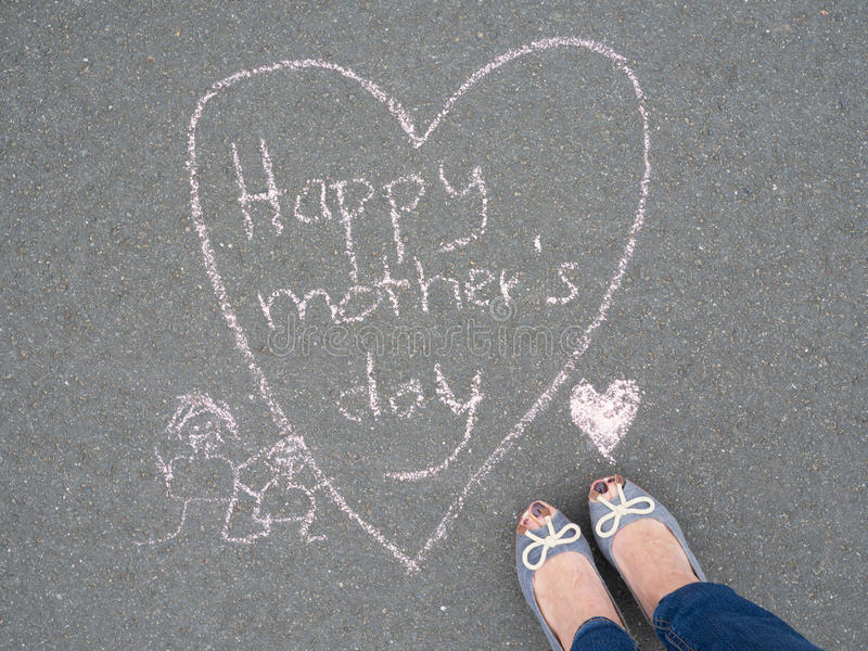 Mothers day - heart shape chalk drawing and the feet of a mother royalty free stock photo
