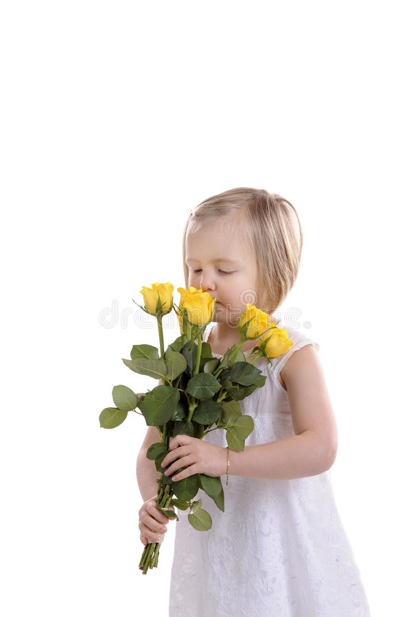 Mothers day little girl with yellow roses royalty free stock photo