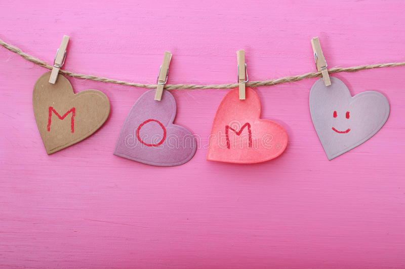 Mothers day message on paper hearts stock images