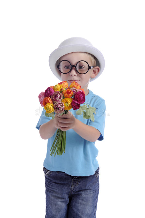 Mothers day: young boy with flowers. Mothers day: young boy with bowler hat, his fathers's coat and a bouqet of flowers stock image