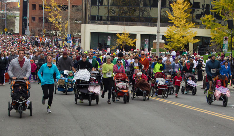 Mothers, father, and babies at the Drumstick Dash, Roanoke, Virginia, USA stock images