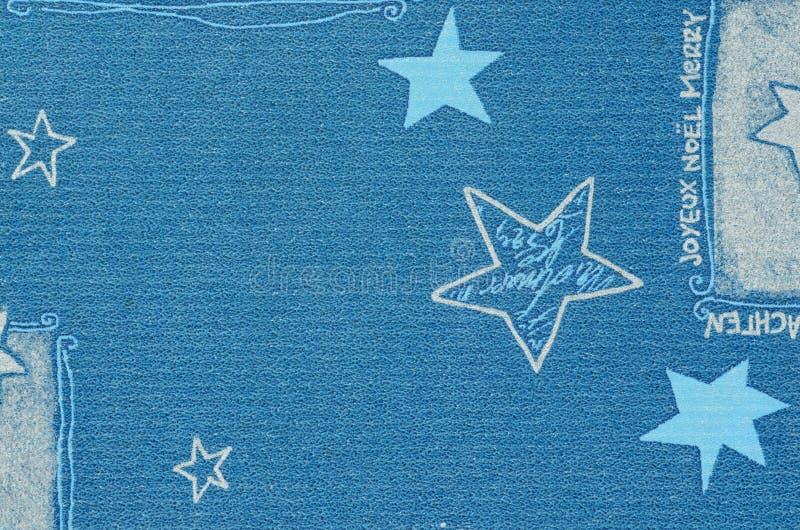 Motif bleu de Noël sur le carton de papier avec l'effet trouble images stock
