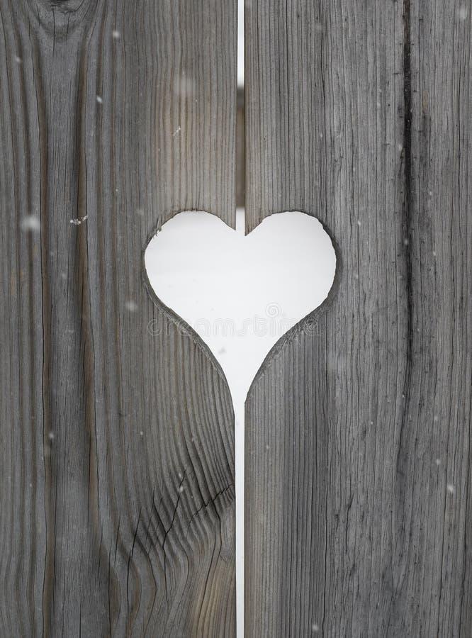 Motif de coeur dans les panneaux en bois de volet image libre de droits