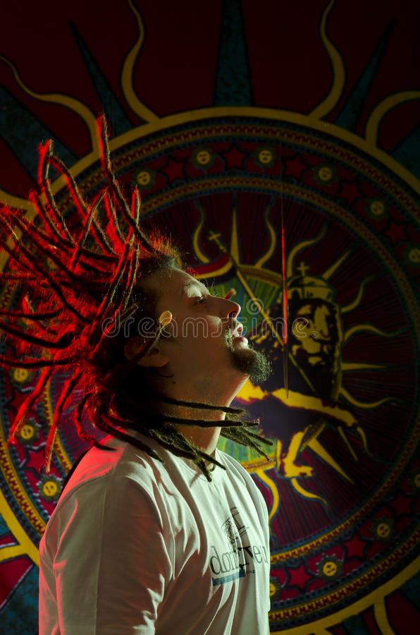 Motion. Shot portrait of a young rastaman with his dreadlocks in motion royalty free stock photos