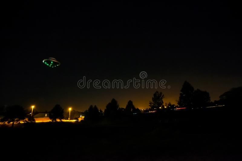 Amateur style night time image of a UFO. Motion Blur Amateur style night time image of a UFO stock photography
