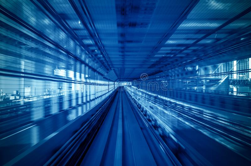 Motion blur of Automatic train moving inside tunnel in Tokyo, Japan royalty free stock image