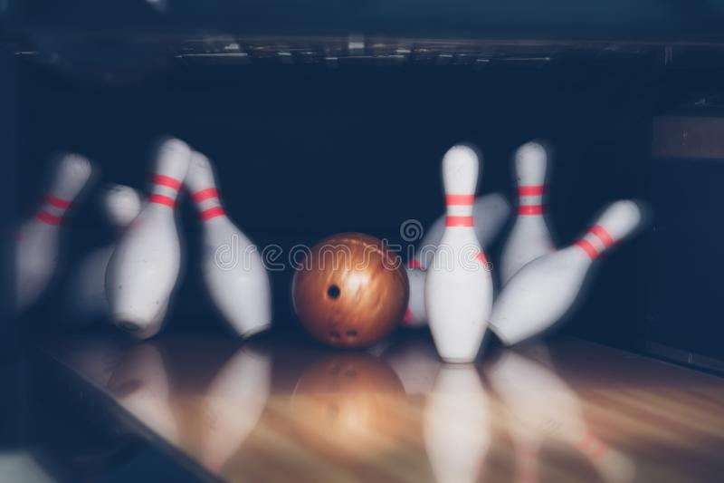 Motion blur of bowling ball skittles on the playing field.  royalty free stock image