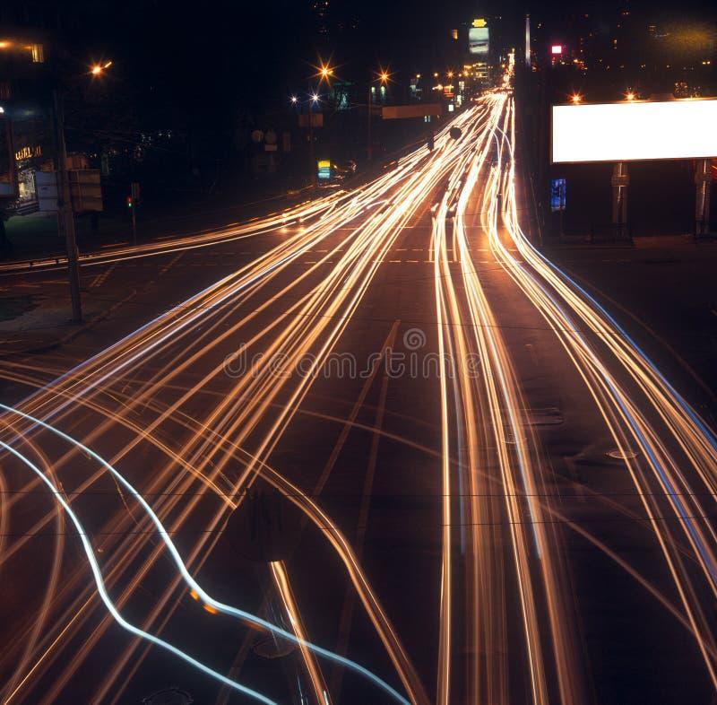 Motion blur of car lights on street at night.