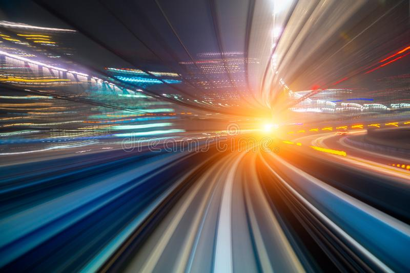 Motion blur of a city and tunnel from inside a moving monorail in Tokyo stock photography