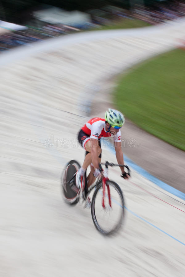 Motion Blur Of Cyclist Sprinting In Time Trial At Velodrome. East Point, GA, USA - August 29, 2015: Motion blur of pro cyclist sprinting during his time trial at royalty free stock photo