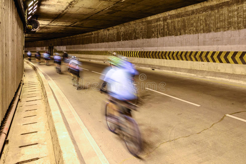 Motion blur of cyclist in underground road royalty free stock photography