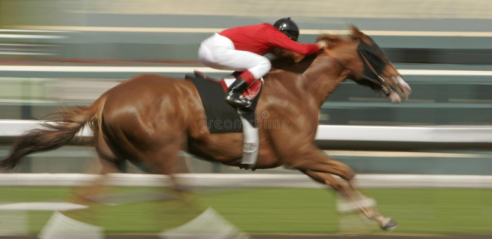 Motion Blur Horse Race. Slow shutter speed rendering of one racing horse and jockey stock photo