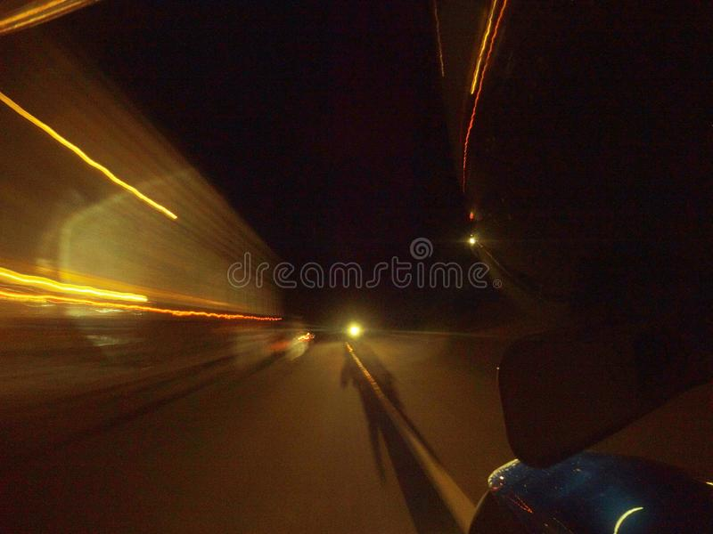 Motion blur long exposure night shot from bike royalty free stock photo