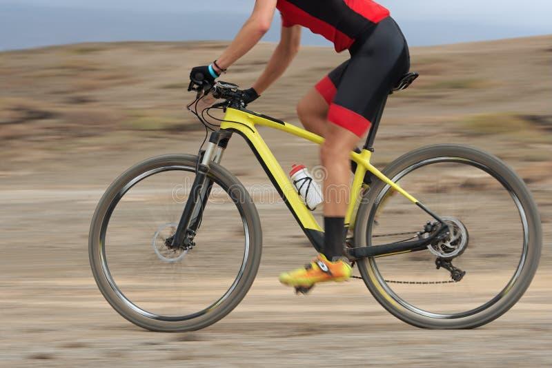 Motion blur of a mountain bike race royalty free stock photo